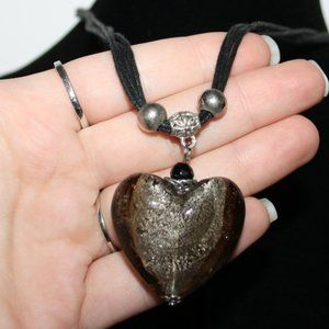 Stunning black necklace with glass heart